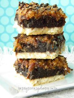 Samoa Brownie Cookie Bars ~ Says: These are so yummy.... they're kind of like those Girl Scout Samoa Cookies, with their shortbread cookie crust, gooey coconut caramel topping and chocolate drizzle, but these naughty little bars sneak in a delightful layer of brownies.