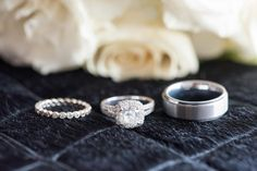Detail ring shot of diamond eternity band by Mikkel Paige Photography for a red, pink and black wedding. #platinumrings #weddingrings #mikkelpaigephotography