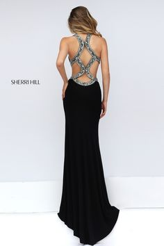 Sherri Hill 50383 prom dress. https://www.pinterest.com/behzadj/jovani-prom-dresses/, https://www.pinterest.com/behzadj/blush-prom-dresses/ or https://www.pinterest.com/behzadj/alyce-paris-prom/ for other cutout back prom dresses. Sherri Hill is selling out fast.