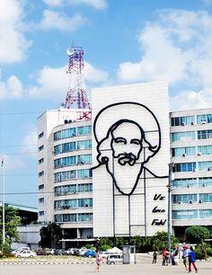 Enrique Ávila Gonzales's sculpture of Socialist hero Camilo Cienfuegos dominates a building on Revolution Plaza; it bears the famous Cienfuegos comment YOU'RE DOING FINE, FIDEL.