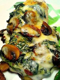 Spinach and Mushroom Smothered Chicken -   3 c  spinach  1 3/4 c mushrooms  3 green onions  1 1/2 tsp olive oil  4 chicken breast  1/2 tsp chicken seasoning  2 slices provolone cheese  Saute spinach, mushrooms, onions in oil. Set aside and keep warm. Sprinkle chicken w/seasoning. Grill chicken, covered on medium heat or broil 4 in. from heat for 5 mins on each side.  Top w/cheese. Cover & grill until cheese is melted. To serve, top each chicken breast with reserved spinach mixture.