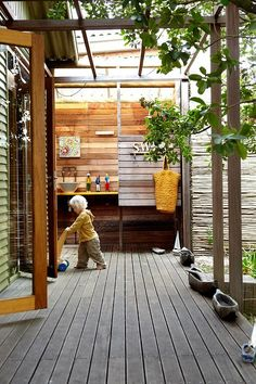 Arbor-covered porch with big wood and glass doors connecting the inside to the outside.