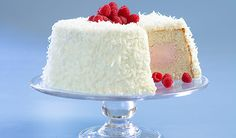 Raspberry Coconut Cloud Cake: A tunnel of raspberry mousse makes this angel (food cake) sing.