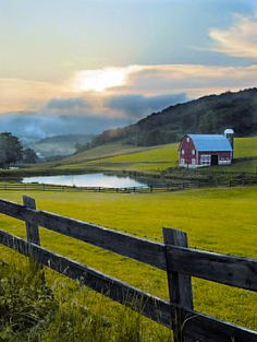 The sun sets above a scenic farm in the Potomac Highlands of West Virginia.