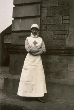 WWI Nurse Wearing a wristwatch, probably similar to the one I pinned beside this picture.  After WWI it was frowned upon by Matron's for nurses to wear a watch on the wrist, hence nurses pendant watches were worn