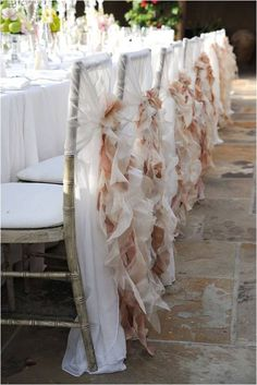 These gorgeous chair covers would be wonderful for a shabby chic wedding. I love the ruffles combining the white and subtle pink tones.