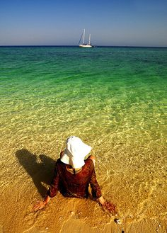 Woman having a quick dip in the RedSea, Dahlak islands, Eritrea by Eric Lafforgue, via Flickr