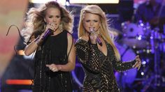 2014 CMT Video Music Awards - Carrie Underwood, left, and Miranda Lambert, right perform on stage at the CMT Music Awards at Bridgestone Arena in Nashville, Tenn.