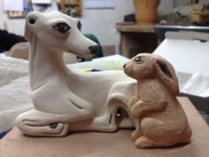 """""""Italian Greyhound and bunny II"""" by Malens Ceramics in proggress. Terra cotta with engobe, ready to be fired. Dog Art."""