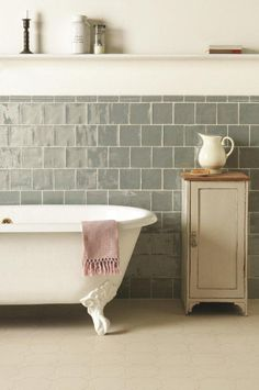 Lazul grey tiles, shown in a beautiful rustic bathroom, from the Metropolitan range which feature a unique lustrous finish. Handmade ceramic tiles which are part of the Residence collection by The Winchester Tile Company. winchestertiles.com