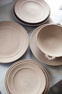 Ceramic bowls with handles, plates