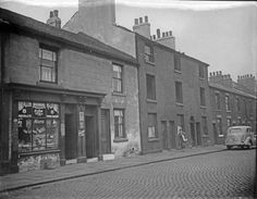 Nos 38-46, Boston Street (formerly New George Street). Court No. 8, at rear of derelict back to back houses in centre. No 46, Mrs Eliz. Ann Bradford, Shopkeeper, left