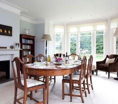 Matching Set  A traditional table and chairs feels less formal when the room is filled with oversized extra seating, bookcases, and relaxed lighting. The overall effect is warm, homey, and practical.