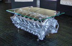 Coffee table made from a piece of glass and an engine block.