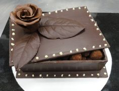 A box made out of chocolate holding chocolates--now that's a chocolate box!