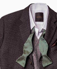 Layered details. Debonair design. Bow tie undressed.