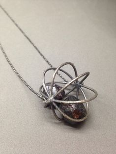 large garnet necklace cage pod necklace oxidized sterling silver modern art jewelry kinetic jewelry