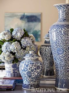 Classic Blue-and-White Touches  Blue-and-white ginger jars frame the view from foyer to living room.  Via TraditionalHome .com