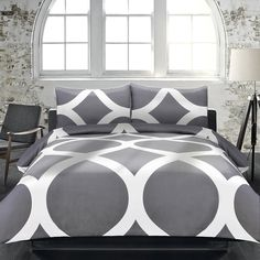 Add a touch of class to your bedroom with this lovely duvet cover set in charcoal grey and white. Constructed of 100 percent cotton, this set is machine washable .
