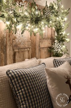 This is magical!  Greenery, white lights and sparkling snowflakes.  Stunning.  Love the deer and gingham cushions too!
