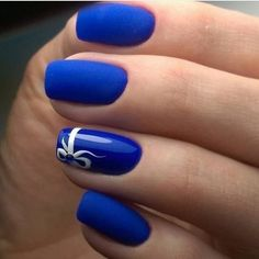 A Combination of Matte and Glossy Blue Nails with White Bow. Ahh! I just love this elegant navy blue nail art design. The nail art incorporates the matte color and glossy color all along with the bow pattern white addition.