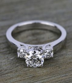 What can we say? No amount of praise will do this ring justice. Light reflects off the platinum band and two Round side stones into the facets of the flawless center diamond, making it appear extra brilliant.