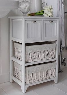 Side View Of The White Bathroom Storage Furniture With 2 Large Willow Drawers And Wooden