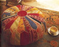 Rich colours, like the idea of making a foot stool - http://www.llph.co.uk/PatchQ2/patchwork-pouffeCC601.jpg