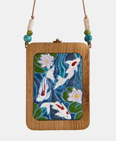 "Koi fish are the domesticated variety of common carp. Actually, the word ""koi"" comes from the Japanese word that means ""carp"". Outdoor koi ponds are relaxing. Koi, Bridesmaid Kit, Wooden Purse, Fish In A Bag, Ceramic Beads, Beautiful Bags, Suede Leather, Purses And Bags, Creative Textiles"