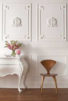 Beautiful modern Rococo inspired interior, making wise selections of lighter shades, the infamous Commode drawer chest with cabriole legs and the whimsical stucco detailing on the wall