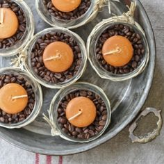 This simple candle and coffee bean centerpiece would be a perfect addition to the Thanksgiving table.