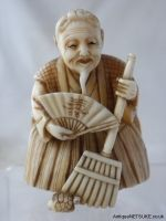 Ivory netsuke with Jo, signed Izumi Gokoro. //  Good ivory netsuke with the figure Jo standing with his broom a minogame at his feet. Signed on the back in metal plaque Izumi Gokoro. Size 49mm high- 35mm wide. Late 19th C