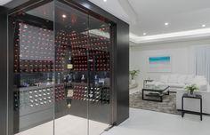 Glass walk in cellar in our award winning display home cellar Custom built Walk in Wine Cellar