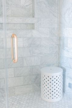 Pretty Shower Tiles - large wall tiles with small hexagon floor tiles, built in shelving, glass doors