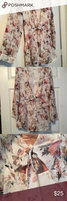 Girly Floral Romper With Tie Top This is the perfect romper to transition into fall. It's long sleeved with pockets. It ties in the front leaving you the option to have a low cut neckline or show off a lacey bralette. Only worn once. Great condition. Loveriche Pants Jumpsuits & Rompers