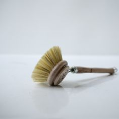 Ditch the ugly plastic dish brushes for this handsome handcrafted beechwood and natural bristle brush for all your dish cleaning needs.  You'll have people lining up in your kitchen to do your dishes with this beautiful tool...okay, maybe not but it'll sure look pretty sitting by the sink!