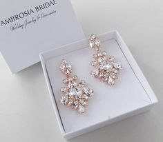 Our Lydia Earrings - Rose Gold and shimmering Swarovski crystals make an elegant statement with your accessories.