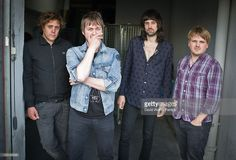 Ian Matthews, Tom Meighan, Sergio Pizzorno and Christopher Edwards pose outside Studio 104 at Album de la Semaine Show at Studio 104 on August 31, 2011 in Paris, France.