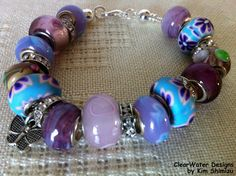 Large Bead Charm Bracelet Lampwork Beads by ClearWaterDesignsbyK, $29.95  A European Style Charm Bracelet at a fraction of the cost!   This bracelet is made with a silver plated snake chain with a twist off ball end cap so that you can change the beads & add charms as you like. IT STANDS OUT FROM THE REST BECAUSE I'VE USED 13 QUALITY BEADS & 6 RHINESTONE RONDELLES The beads are Handmade & Hand Painted! Find more like this at http://www.etsy.com/ca/shop/ClearWaterDesignsbyK?ref=si_shop