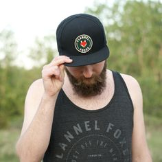 This high quality Snapback hat features a deep green Flannel Foxes patch. It is a black hat with a green under brim. One size fits all! Cute Tomboy Style, Fox Hat, Tomboy Fashion, Androgynous, Snapback Hats, Foxes, One Size Fits All, Squad, Flannel