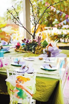 A ridiculously cute Tink party. I love the twigs as centerpieces. Also bubble wands as gifts!