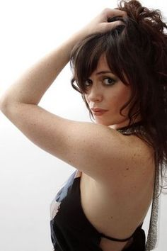 Torchwood's Gwen Cooper, she can kick Lara Crofts arse, twice, before breakfast :)