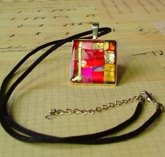 Friendly Plastic metallic pendant - pink, red and gold via Etsy.