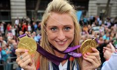 Cyclist Laura Trott shows her pair gold medals.