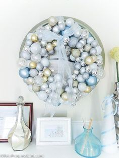 Make your own DIY Ornament Wreath with ornaments from the dollar store! Such a cheap and beautiful project!