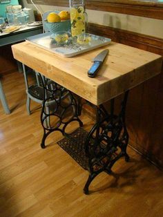 Butcher block top added to sewing machine base makes a perfect little kitchen island!