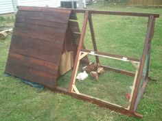 I built this chicken tractor for my wife out of reclaimed pallet wood. I also used an old blue tarp under the shingles to make sure it was dry on the inside. It has two doors one in the front with a rope to let them one and out and one in the rear for easy clean out. It has one side door to let them go free range for a while everyday.