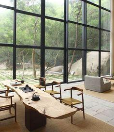 full height windows, glazed wall, massive wood table