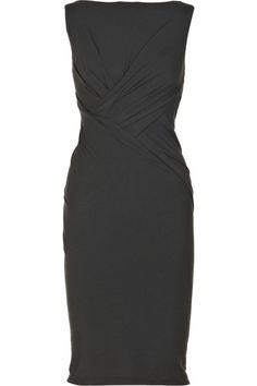 Donna Karan dress is sleeveless, has a high neck, a V-back