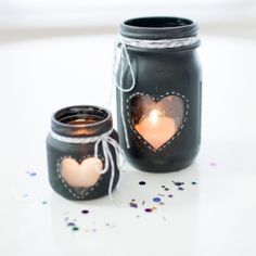 Chalkboard spray paint + painter's tape + mason jars (or baby food jars) = Our super cute and easy to make DIY Candle Centerpiece!!